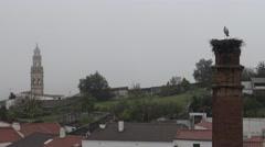4K Stork on the nest over a column a raining day of Jerez de los Caballeros-Dan Stock Footage