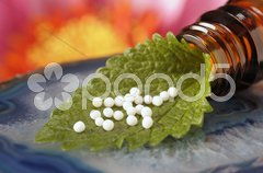 Homöopathie mit Globuli Stock Photos