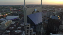 Rising Orbit Around Skyscraper As Sun Sets Behind Nashville Skyline Stock Footage