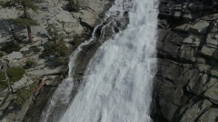 Rising High to Birds Eye View of Epic Mountain Waterfall Stock Footage