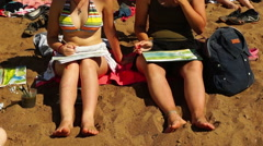 Barefoot girls painting on the beach Stock Footage