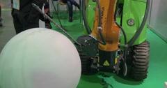 On exhibition Robotix expo seen industrial robot Kuka Stock Footage