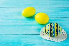 Yellow hand-painted Easter eggs Stock Photos