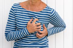 Woman suffering severe chest pains Stock Photos
