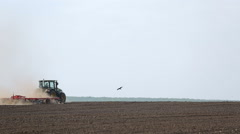 Treatment of soil by using a plow and tractor Stock Footage