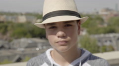 Close up of a good looking teenage boy wearing a very fashionable hat. 4K. Stock Footage