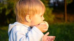 The beautiful child eats the ice cream Stock Footage