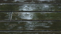Closeup of wooden deck during rainstorm. Haliburton, Canada. Stock Footage