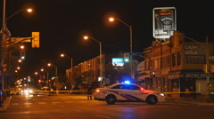 Police close Danforth Avenue after shooting in Toronto, Canada. Stock Footage