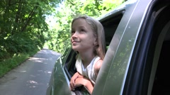 4K Girl Traveling by Car, Child Face Looking Out the Window, Kid Admiring Nature Stock Footage