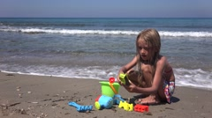 4K Girl Playing on Beach, Child Portrait with Sand Toys on Seashore, Children Stock Footage