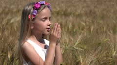 4K Girl Portrait Praying in Wheat Field to Rain Pensive Child Meditating Outdoor Stock Footage