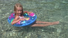 4K Girl Swimming in Sea Water, Beach View, Child Enjoying Summer Vacation Stock Footage