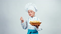 Chef cook child 7-8 years holds plate with pasta and dancing isolated on white Stock Footage