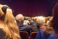 Audience in theathre waiting for drama play to start. Stock Photos