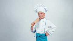 Chef cook child 7-8 years holds rolling-pin and isolated on white background Stock Footage