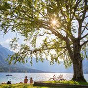 Couple enjoying beautiful nature around lake Bohinj, Slovenia. Stock Photos