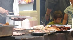 Selling a food on a street festival - people eating meat dishes Stock Footage