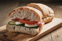 Italian sandwich with speck and mozzarella Stock Photos