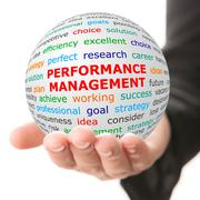 Hand take white ball with red inscription Performance management Stock Photos