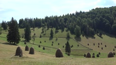 4K Haystacks on Mountains Hills, Alpine Nature Landscapes, Rustic, Pastoral View Stock Footage