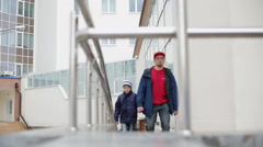 Father and son walking on the wheelchair ramp Stock Footage
