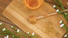 Composition of honey and honeyspoon. Honey pouring down on honeyspoon (No 12.3) Stock Footage