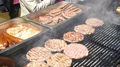 People buy grilled meat dishes on a street food festival Stock Footage