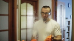 Man cleaning a mirror with a cloth. Slow motion Stock Footage