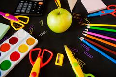 Material for school, paper clips, pencils, colors, scisor and notebook Stock Photos