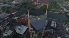 High Orbiting Nashville Skyscraper At Sun Set Over River Stock Footage