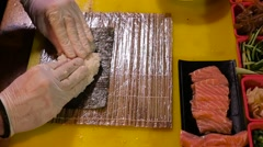 Chef prepares sushi roll  with  salmon fish  Stock Footage