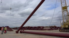 Lifting and installation of the metal supporting columns at the building site. Stock Footage