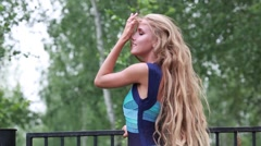 Beautiful girl with very long hair plush Stock Footage