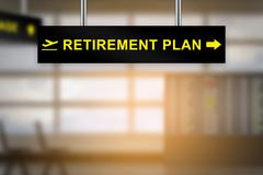 Retirement plan on airport sign board Stock Photos
