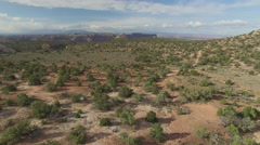 Flying Low Over Desert Towards Distant Canyon Stock Footage