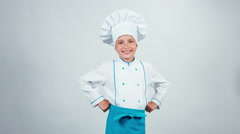 Chef cook child 7-8 years showing okey at camera standing isolated on white Stock Footage