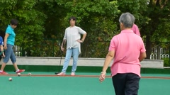Shenzhen, China: the elderly in playing croquet exercise Stock Footage