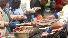 People buy meat dishes grilled on big street food festival in Sofia Stock Footage