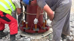 Mounting of the metal supporting column at the building site. Fixing huge nuts. Stock Footage