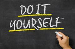 Do it yourself written on a blackboard Stock Photos