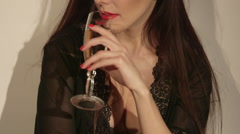 Young woman in sexy lace lingerie drinking champagne while sitting on floor Stock Footage