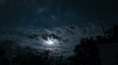 Night Moon Rising on the Horizon over the Trees and Clouds. Time Lapse Stock Footage