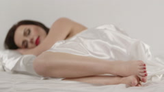 Pretty woman lying in bed closed her eyes and began to fall asleep Stock Footage