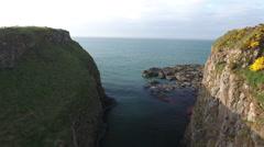 Flying Between Rocks on Ireland Coast Stock Footage