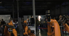 View of industrial robots that moving with light sticks Stock Footage