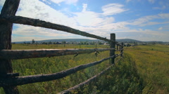 It is landscape of wooden fence in small village Stock Footage