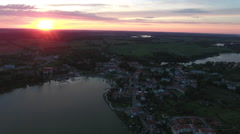 Very High Over Polish Lake and Town at Sunset Stock Footage