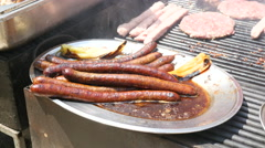 Sausages fried on grill on street food festival in Sofia Bulgaria Stock Footage