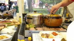 Different food dishes layout showcase in a street food festival in Sofia Stock Footage